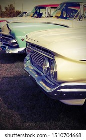 Tillsonburg, Ontario / Canada - September 14, 2019 : Wings and Wheels Event showing an early 1960's Chevrolet front end and late 1950's year cars behind.