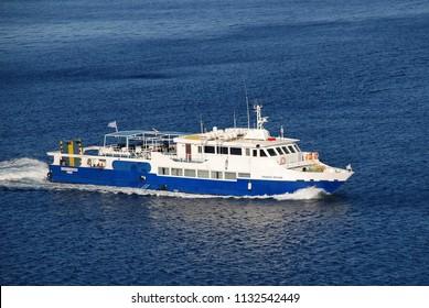 TILOS, GREECE - JUNE 12, 2018: Passenger ferry Panagia Spiliani arrives at Livadia harbour on the Greek island of Tilos. The 42.65mtr vessel was built in 1998.