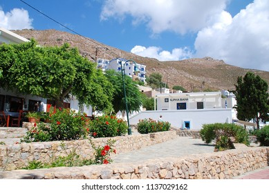 TILOS, GREECE - JUNE 17, 2018: The main square of Livadia town on the Greek island of Tilos. The small Dodecanese island has a population of around 780 people.