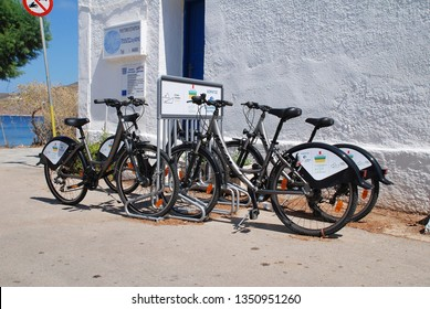 TILOS, GREECE - JUNE 18, 2018: A bicycle rank on the seafront at Livadia on the Greek island of Tilos. Cycling and walking are popular activities on the Dodecanese island.