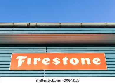 Tilst, Denmark - January 17, 2016: Firestone logo on a building. Firestone is an American tire company founded in 1900 and the company was sold to the Japanese Bridgestone Corporation in 1988