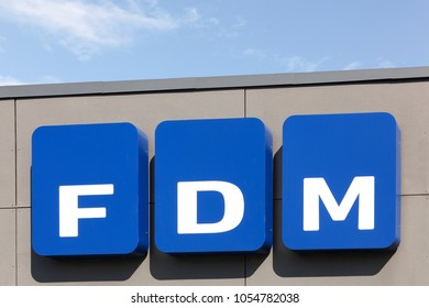 Tilst, Denmark - May 16, 2016: The Federation of Danish Motorists logo on a wall. FDM is an organisation created in 1909 as a spin-off from the Danish automotive interests magazine Motor