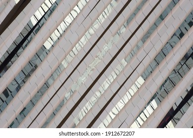 Tilt double exposure photo of structural glazing. Wall and windows of hi-tech building. Abstract futuristic or modern architecture. Diagonal geometric background. Polygonal pattern of glass panels.