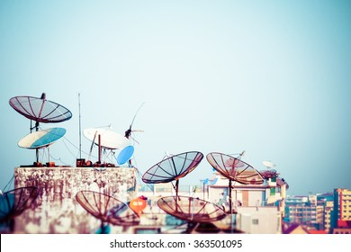 Tilt shift blur effect. Abstract Yangon cityscape with parabolic satellite dishes at building roofs. Myanmar (Burma) travel landscapes and destinations
