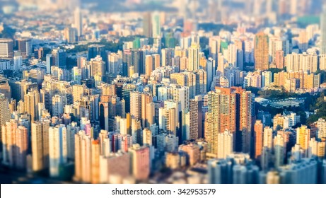 Tilt shift effect. Abstract futuristic cityscape with modern skyscrapers. Hong Kong aerial view evening panorama