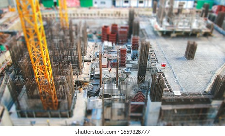 Tilt shift effect photo of the construction site of a large building