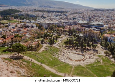 Tilt shift effect of the Theater of Dionisio and the Odeo of Pericles with the city of Athens in the background, Greece
