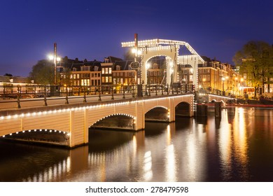 tilt shift image of skinny bridge in Amsterdam, the Netherlands, miniature night scene