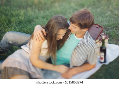 tilt shift and motion effect. couple in love on Valentine's day walking in a summer Park on a Sunny day. a romantic date on February 14. relationships of teenagers. emotional portrait of students