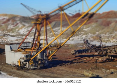 Tilt shift picture. Open development. Huge machines manganese ore is mined in open pits. Metallurgical industry in Ukraine.