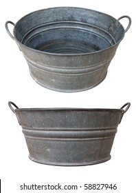 Tilt and side view of an antique metallic basin or tub with some water in it,  isolated over white with both separate clipping paths