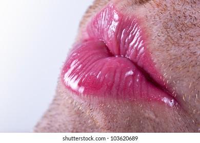 Tilt view close up of lipstick on a unshaven man