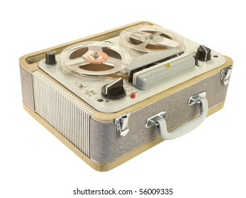 Tilt view of an old portable reel-to-reel tape-recorder, isolated over white. Clipping path is included