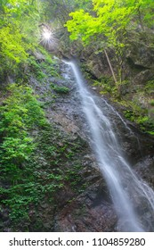Tilted view of waterfall in the forest, the Hossawa falls in Hinohara village. Tokyo, Japan.