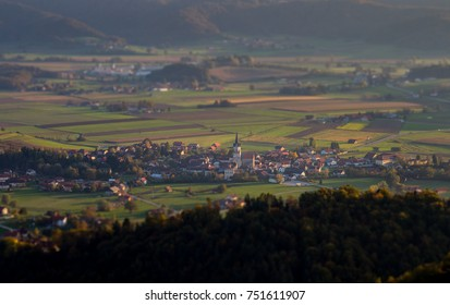 A tilt-shift photo of the scenic sunseting village of Sentrupert in Dolenjska Region.