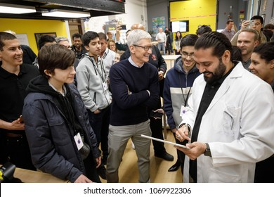Tim Cook, Chief Executive Officer of Apple Inc., looks at a iPad as he torus a technology lab at an educational focused event at Lane Technical College Prep High School in Chicago, March 27, 2018.