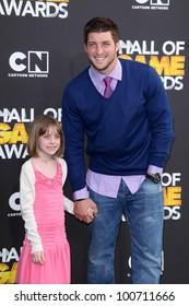 Tim Tebow, Presley Collins at the Cartoon Network Hall of Game Awards, Barker Hangar, Santa Monica, CA 02-18-12
