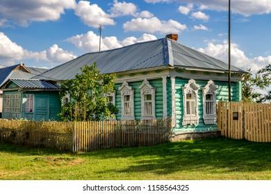 Timashovo, Russia - August 2018: Old village log house with beautiful carved platbands. Zhukovsky district, Kaluzhskiy region