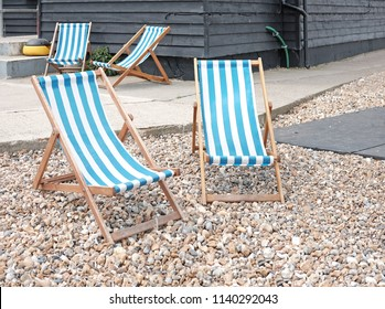 Timber beach chair on Whitstable Beach, Whitstable, England.