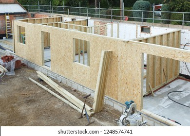 Timber frame house extension or annexe under construction in the UK