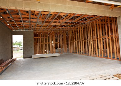 Timber frame work for the garage space of a residential home being built in suburbia