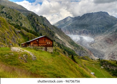 timber hut in front of Aletsch glacier valley