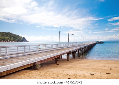 The timber Nelly Bay Jetty on Magnetic Island, near Townsville Australia
