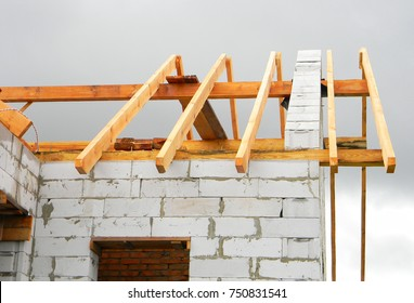 Timber roof trusses building. Wooden Roof Frame House Construction.