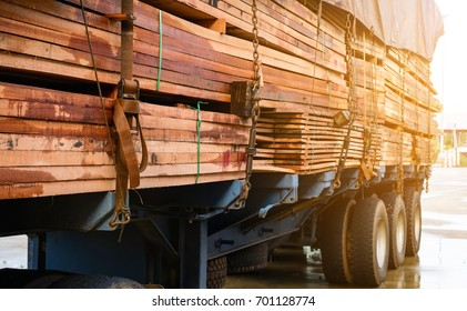 Timber transport truck Park waiting for inspection with lumber for construction.selective focus