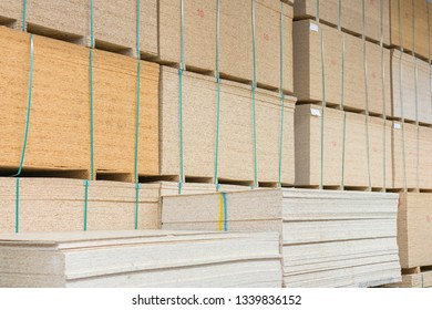 timber in warehouse. Pallet with boards in the hardware store. Packed boards in the building store. building materials. warehouse with variety of timber for construction and repair