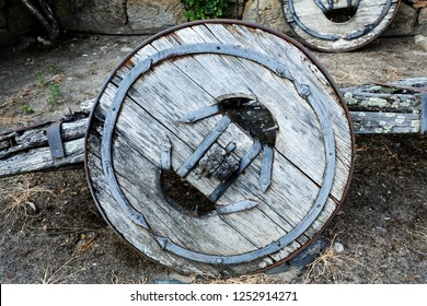 Timber wheel of a traditional two-wheeler ox cart (or bullock cart) entirely made of timber in advanced state of disrepair, in Northern Portugal