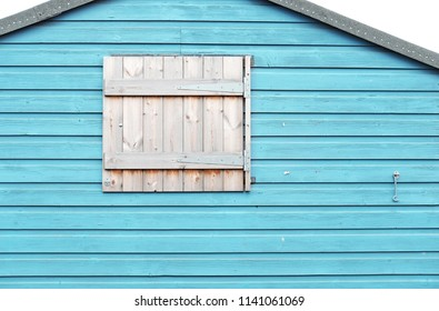 A timber window of a beach hut in Whitstable, England.