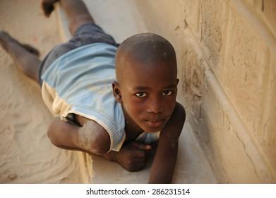 Timbuktu, Mali. september-02-2011 Child playing alone on a street in Timbuktu