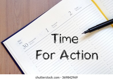 Time for action text concept write on notebook with pen