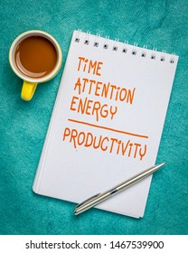 time, attention, energy - productivity concept - handwriting in a spiral sketchbook against turquoise textured bark paper with a cup of coffee