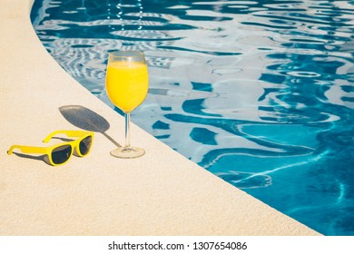 Time to book vacation - resort view - juice and sunglasses
