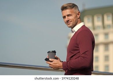 Time to call family. Lunch break. Coffee break and pleasant conversation. Mobile call. Internet surfing. Relaxing. Man with smartphone and coffee cup outdoors. Drink coffee and relax. Daily rituals