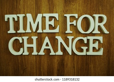 time for change alphabet letters top view on wooden background