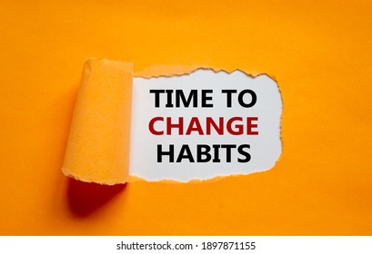 Time to change habits symbol. The text 'Time to change habits' appearing behind torn orange paper. Business, growth and time to change habits concept. Copy space.