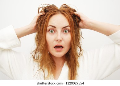It's time to Change the Hairstyle. A Caucasian Young Women with Red Wet Hair,  Damp,  Holds her Hands on her Head. Isolated, Portret. - Shutterstock ID 1120029554