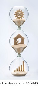 Time for clean energy concept with falling sand taking the shape of an eco house inside a hourglass