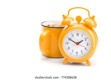 time for a coffee break, orange cup and alarm clock isolated on white background