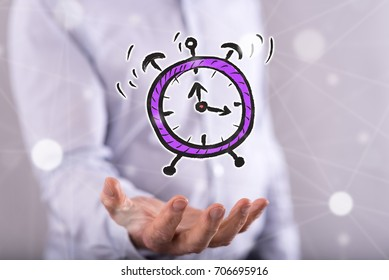 Time concept above the hand of a man in background