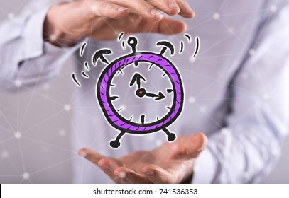 Time concept between hands of a man in background