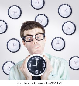 Time concept of a business man standing with clock in hand while making a choice between the past present and future