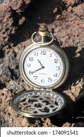 Time Concept Classic Vintage Pocket Clock on the Volcanic Rocks