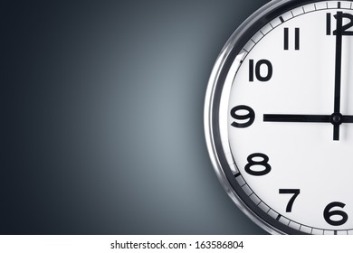 Time concept. Close up view of clock on wall with copy space, time to work.