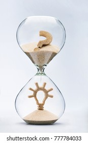 Time is creativity concept. Light bulb made out of falling sand from question mark flowing through hourglass.