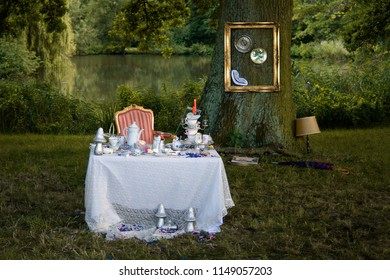 """Time to drink tea. 5 o'clock. """"Eat me"""". """"Drink Me"""". The scenery for """"Alice in Wonderland"""" and the smile of a Cheshire cat."""