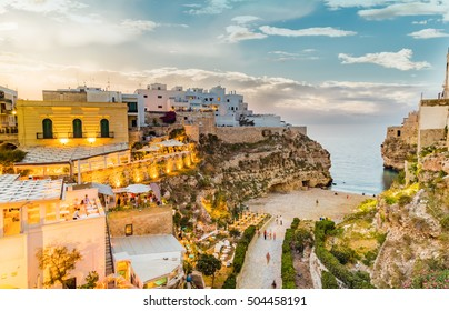 time of dusk on the village of Polignano, in Puglia, Italy
